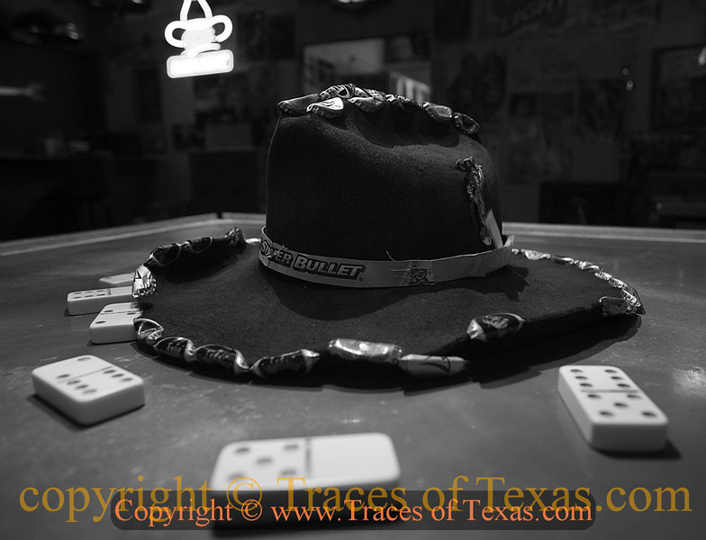 Title:   Only True Party Animals Wear this Hat<br /> <br /> Comments: This hat, with its custom beer bottle cap brim and crown, is worn only by the truly worthy at Mynars bar.<br /> <br /> Location: West