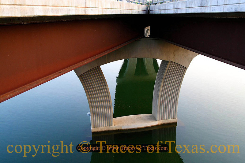 Title:   Can You be Certain that Fish do not Dream?<br /> <br /> Comments: This may be my very favorite photo, speaking to me as it does of downtown Austin and reminding me of the many great times I've had along the shores of Lake Lady Bird. The First Street Bridge is a classic. <br /> <br /> Location: Austin Texas