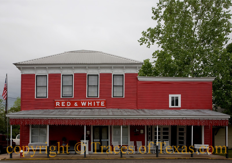 "Title: Red and White<br /> <br /> Comments: I find these old Red and White grocery stores in small towns all over the state. They were ""mom and pop"" stores that were owned by local townspeople and survived for decades.  Unfortunately, I don't know of a single one that remains in business.  I guess that, as people became more mobile, they decided that it was better to drive 30-40 miles into a large city a couple of times a month and shop at a large place that has more variety and less soul. It's the ""H-E-Bification""  of Texas.  <br /> <br /> Location: Fayetteville"