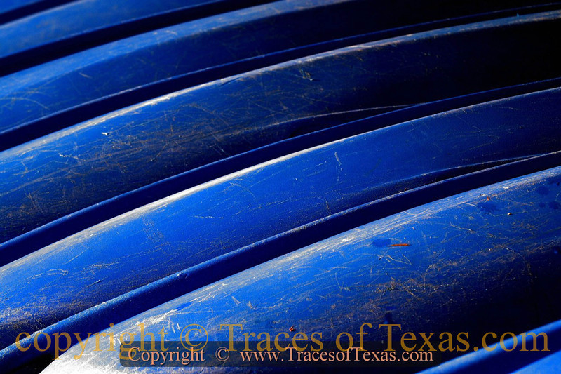 Title:   Sleep Little Kayaks, Don't You Cry<br /> <br /> Comments: Blue Kayaks making a nice abstract on Lake Lady Bird.<br /> <br /> Location: Austin, Texas