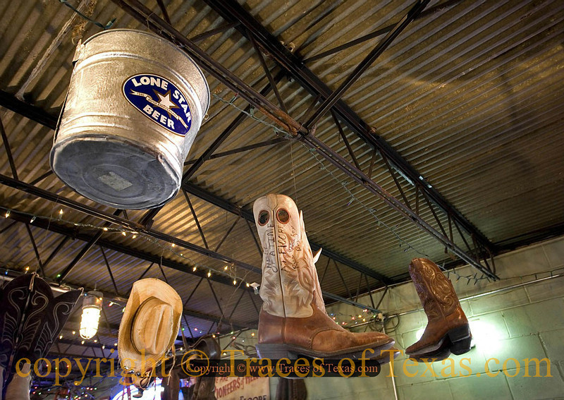 Title:   When Old Cowboy boots Die and Go to Heaven<br /> <br /> Comments: Honky-Tonk decor <br /> <br /> Location: Helotes, Texas