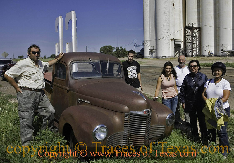Title:   Vive le Route 66!<br /> <br /> Comments: I met these friendly French folks on Route 66 in Adrian, Texas. They were doing the entire route, all 2300 miles of it, on motorcycles. A man's gotta respect that, so I made them honorary Texans. <br /> <br /> Location: Adrian, Texas