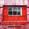 Title:   Red Red Window<br /> <br /> Comments: I don't know what is in this barn, but it must be pretty valuable. <br /> <br /> Location:  Helotes
