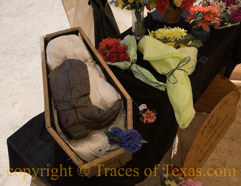 Title:   Funeral for a Good Boot<br /> <br /> Comments: We laid old Lefty to rest in a custom-made casket. He was a mighty fine boot. Then we had a wake, west-Texas style. <br /> <br /> Location: Terlingua
