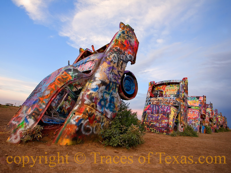 Title: Stanley Marsh: Visionary or Insane?<br /> <br /> Comments: I can never decide whether Stanley Marsh's Cadillac Ranch is art or folly or both or neither. Surely my grandparents, rooted in the Great Depression, would have thought so.  Whatever else  the Cadillac Ranch is, it is certainly a place at which joy happens. That's got to count for something, right?<br /> <br /> Location: Amarillo