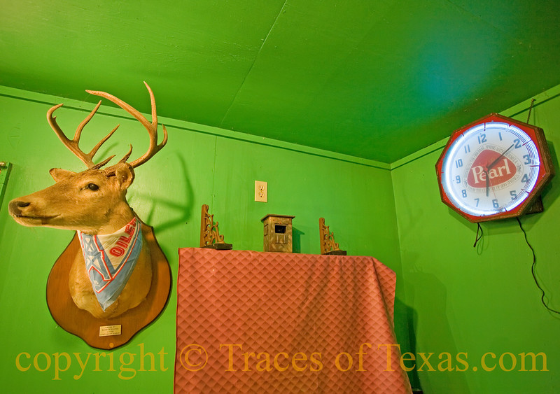 Title: Honkytonk Feng Shui<br /> <br /> Comments: As you can tell, the Tofel Bar uses an ancient Texas system of aesthetics that places stuffed deer heads and old Pearl beer clocks in perfect counterbalance with one another in order to achieve a zen-like state of honkytonk harmony.   Mind you, this is no accident. It takes years of study to achieve this kind of casual, offhand mastery. <br /> <br /> Location: Ammansville