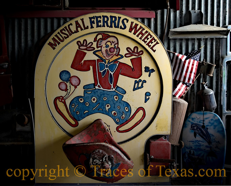Title: Kind Of Freaky, Eh?<br /> <br /> Comments: You never did know what you'd run across in his barn.  The clown face coming out of the seat at the bottom of the photo is just extremely bizarre.<br /> <br /> Location: Dripping Springs