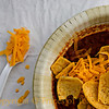 Title: Breakfast of Champions<br /> <br /> Comments: It's hard to explain the allure of Frito Pie. Suffice to say that it is food for the Texas soul. I exalt it at every opportunity.  I took this photo at last Saturday's tailgate. <br /> <br /> Location: Any tailgate anywhere in Texas, any high school football game etc...
