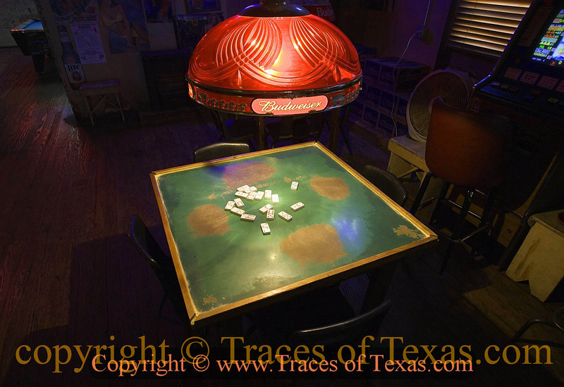 Title: How to Know Whether You're in a Texas Bar, # 232<br /> <br /> Comments: Have the dominoes worn smooth places on the tabletop over the decades? We'll you're in a Texas bar!<br /> <br /> Location: West