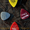 Title:   Remembering Stevie Ray<br /> <br /> Comments: There is a statue of Stevie Ray Vaughan in along Lake Lady Bird in downtown Austin. These are guitar picks that have been left as memorials to the great bluesman. <br /> <br /> Location: Austin