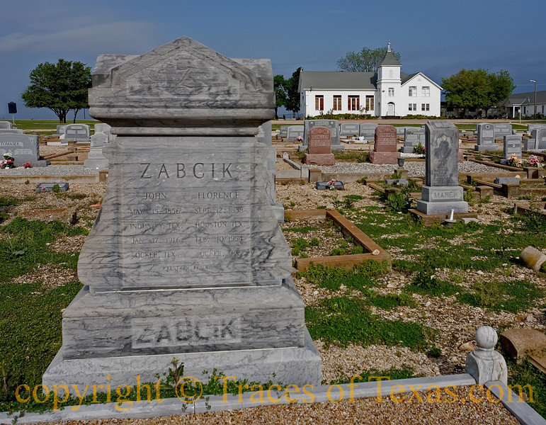 Title:   Blackland Burial<br /> <br /> Comments:  John and Florence Zabcik have been gone for many years, but the church they attended still stands and the Ocker Cemetery in which they are buried is still well-maintained.  The town of Zabcikville is named for them. <br /> <br /> Location: Zabcikville