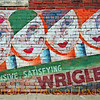 Title:   Wrigley's ... Inexpensive .... Satisfying ...<br /> <br /> Comments:  Ghost sign<br /> <br /> Location: Bartlett