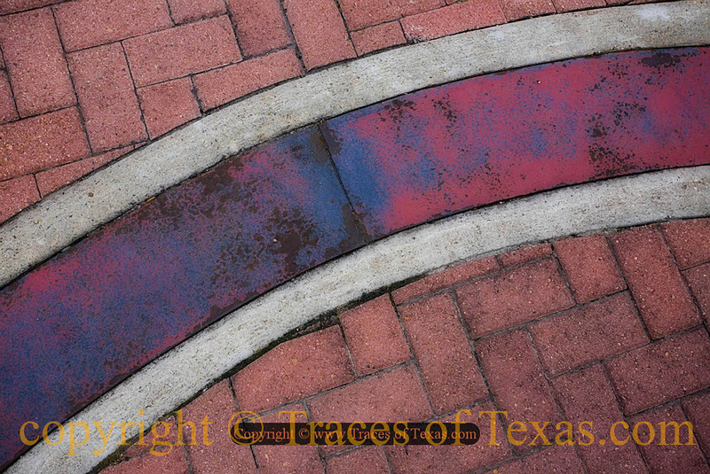 Title:   Brenham in Abstraction<br /> <br /> Comments: Brick street and walkway in downtown Brenham.<br /> <br /> Location:  Brenham, Texas