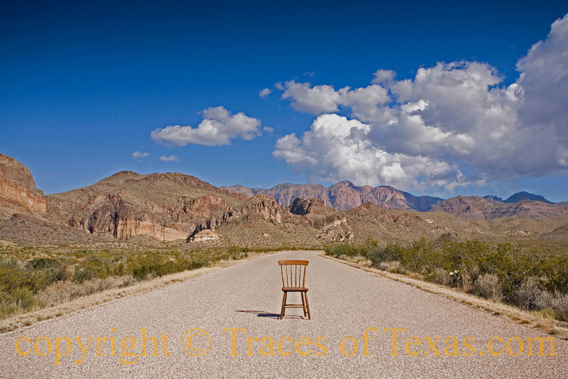 """Title:   Darcy's Chair<br /> <br /> Comments: This is the exact spot where Darcy and I found this chair 31 years ago. It was way out here just sitting in the middle of this road, just like this. Darcy thought it must be a sign of some kind. I'll never forget that she said """"So vast a universe out there, so many possibilities. And this chair, here.  HERE! What an omen for the mind!""""  She figured that it was meant for her, that fate had left it here for her to find for some reason. When I pointed out that I had actually spotted it first and that maybe fate intended for ME to have it, she said """"why would fate intend for YOU to have it?""""  I had to admit that her logic was pretty powerful.  <br /> <br /> Location:  West Texas"""