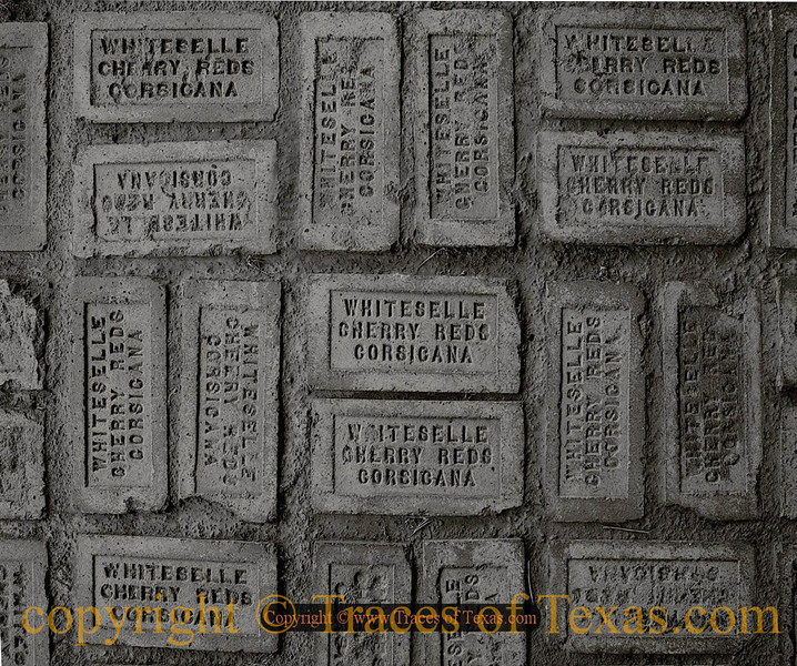 Title:   Corsicana Capture<br /> <br /> Comments: 100 year old bricks in downtown Corsicana.<br /> <br /> Location: Corsicana, Texas