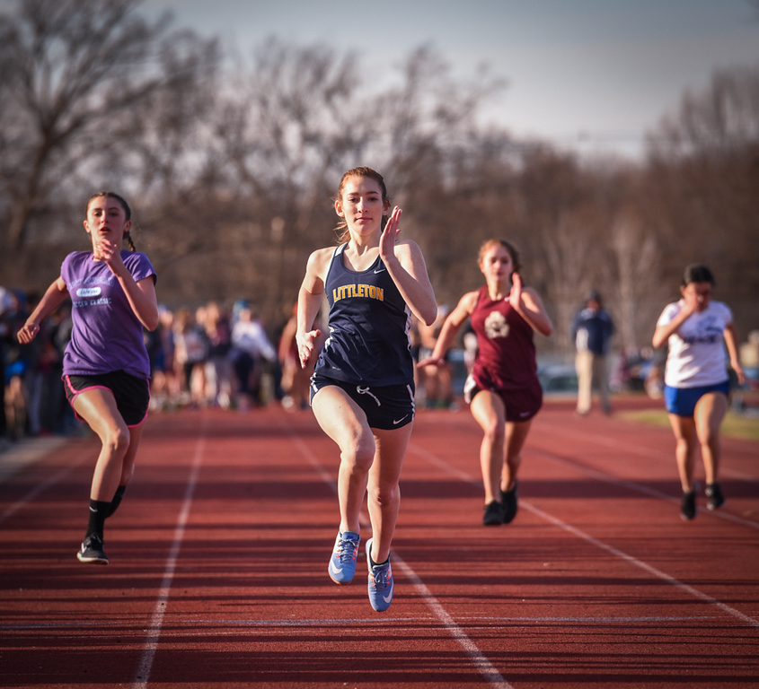 . Littleton\'s Chloe Sturtz, (c), sophomore, in her 100 meters against Ayer Shirley.  Photo: SUN/Scot Langdon
