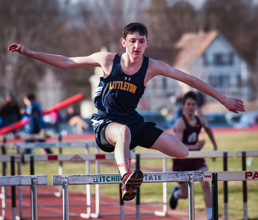 . Jesse Sturtz, a Senior at Littleton on the 110 meter high hurdles Monday afternoon at Ayer Shirley.  Photo: SUN/Scot Langdon