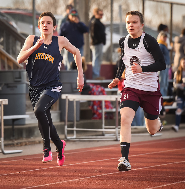 . Ian Mountford, (L) of Littleton, runs neck and neck with Jason Frisoli of Ayer Shirley in the 110 meter and takes a win Monday afternoon at Ayer.  Photo: SUN/Scot Langdon