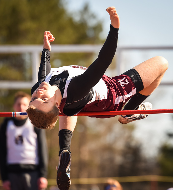 . Ayer Shirley Senior, Liam Mountford, attempts to clear the 5 foot high jump Monday afternoon against Littleton.  Photo: SUN/Scot Langdon