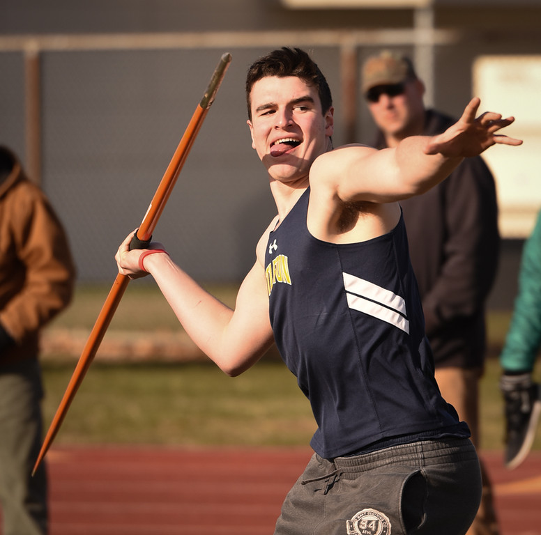 . Littleton\'s Jackson Ellis throws a 93.2 foot javelin during Monday\'s meet against at Ayer Shirley.  Photo: SUN/Scot Langdon