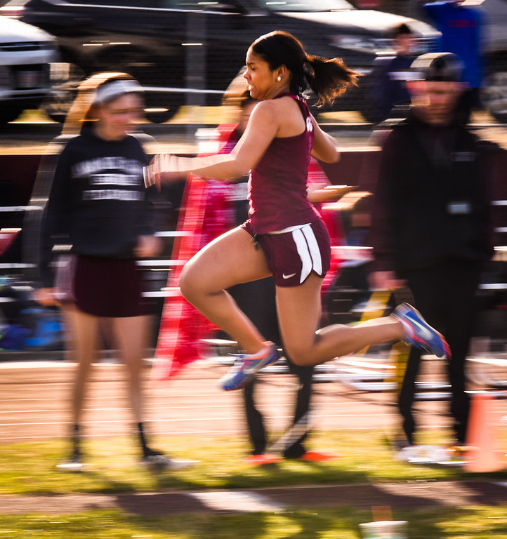 . Ayer Shirley\'s sophomore, Eryca Lopes, takes flight during her long jump against Littleton on Monday at Ayer.  Photo: SUN/Scot Langdon