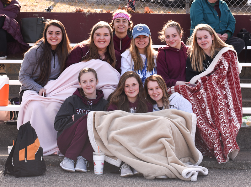 . WARMING UP WITH FRIENDS  Ayer Shirley track supporters on Monday against Littleton from top left:  Vanessa Serrano, Samantha Lawton, Mason Casavecchia, Abigail Lee,Kimberly Fraher, Chelsea Young.  Front:  Mackenzie Taylor, Katrina Kidder, Meghan Simmons.   Photo: SUN/Scot Langdon