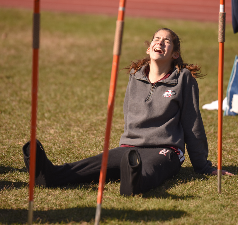 . Ayer Shirley freshman, Sharlize Perez, gets a laugh with friends about her baggy pants as she waits her turn at the javalin throw Monday afternoon against Littleton.  Photo: SUN/Scot Langdon