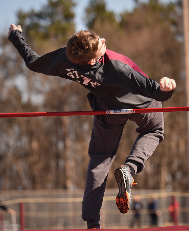 . Ayer Shirley\'s Ed Ernst clears the 5 foot high jump Monday afternoon against Littleton.  Photo: SUN/Scot Langdon