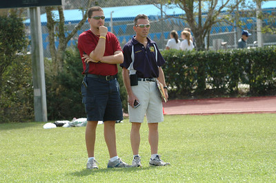 Oak Hall's Edwin McTureous and Holy Trinity's Doug Butler. Is that a GameBoy in Doug's hand?