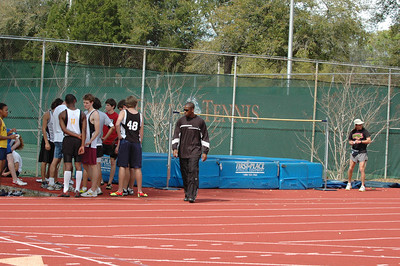 Maclay School's Coach Gary Droze (r) sets up the HJ area for a scheduled 41 girl + 49 boy competitors.