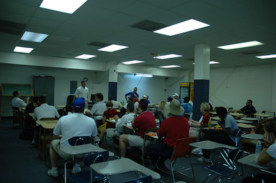 Meeting of the coaches. As the coaches gorge themselves on free food, Bolles Head Coach Dan Dearing lays out how we'll keep it moving throughout the day.