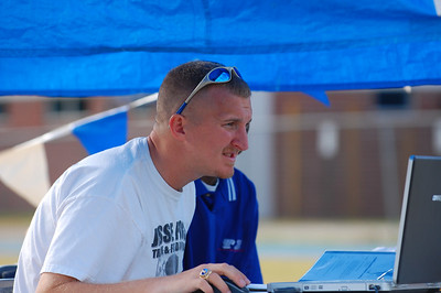 Godby Coach Chris Sumner has one of the most demanding jobs in many area meets - setting up and operating the FinishLynx/Hy-Tek timing/results.