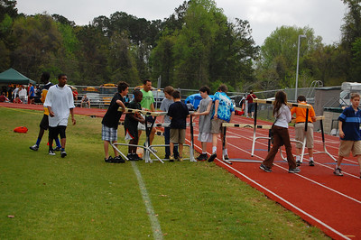 Coach McGrotha brought out his PE class to see some action. They became the action, as they did most of the work placing hurdles for the Girls' 100mHH.