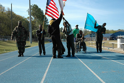 The East Gadsden HS ROTC preparing for color guard duty.