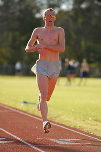 Dathan Ritzenhein, from the visiting Boulder Performance Training Group, marks his time some 35 minutes after completing a 12Km workout on the Maclay School track. The workout was a 3Km pace/1Km float X3. More photos here:  http://tallahasseetrails.smugmug.com/gallery/2534821 Read about the BPTG here:  http://www.bouldertraining.com/