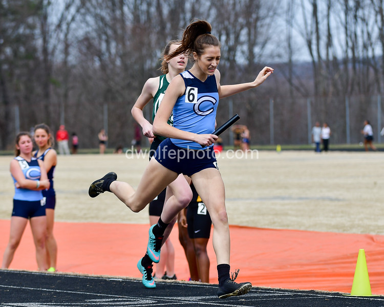 """In one of the more exciting heat finishes of the day, Clarksburg's """"A"""" relay anchor, Lily Lippert over takes Walter Johnson's relay team at the finish line to  secure second place overall in the girls Swedish Relay (SMR).   9th Annual Screaming Eagles Invitational.  Photos by David Wolfe ©"""