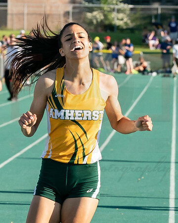 Amherst Alexis Alston exhausted after winning the 400m at the regional final at Amherst Friday May 25.  photo Joe Colon