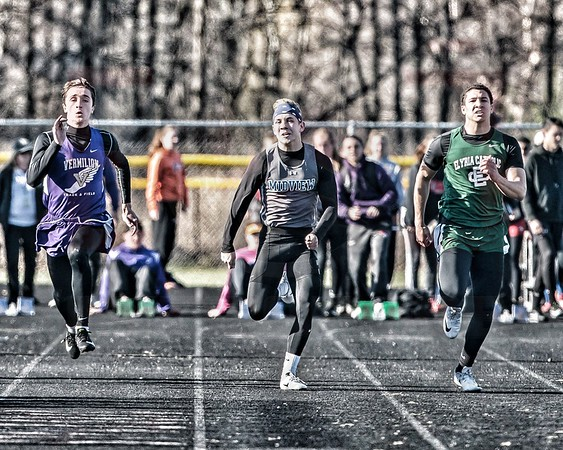 Elyria Catholic Chris Jackson was winner of the 100m dash while Vermilion Zack Kelly was second and Midview Ben Gendics was third Friday April 20.  photo Joe Colon
