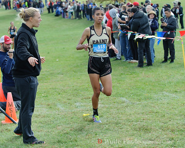 Yasmine Kass of Paint Branch finished second as she crosses the finish line at  18:36.1 in the 2016 Montgomery County Cross Country Championships.
