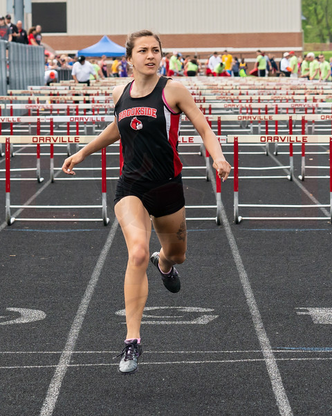 Brookside Jordyn Shawver looks up for her time after competing in the 100 hurdles at the Orrville Districts Saturday May 19.  photo Joe Colon
