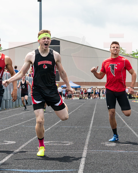 Brookside David Chambers celebrates after winning the 400m, Firelands Blake Ruffner finished third to also advance to next week regionals.  photo Joe Colon