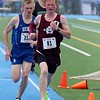 Ayer Shirley Regional High School senior Ethan Matthews leads the way intio the last lap of the 1 mile at the meet held at Lunenburg Middle High School on Saturday afternoon followed close behind by Lunenburg Middle High School senior Chris McCauliff. SENTINEL & ENTERPRISE/JOHN LOVE.