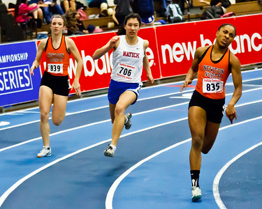 Carla Forbes, Madison Nadeau, and  Laurie Femmel face off in the 300m at the Newton North vs. Natick dual meet.