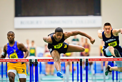 Perry Nowell of Springfield Central on the way to winning his 55m hurdles trial heat in the Massachusetts Division 1 Indoor State Track Championships. He went on to win the final in 7.75