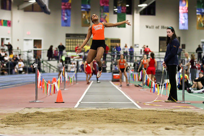 Carla Forbes in the air leading Newton North to a meet record in the 3xLJ relay at the MSTCA Division 1 State Relays on January 21st.