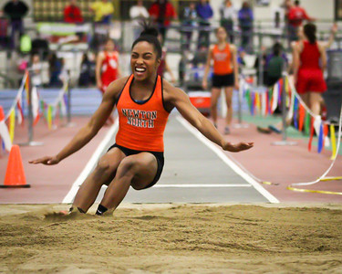 Carla Forbes lands and 18 ft jump leading Newton North to a meet record in the 3xLJ relay at the MSTCA Division 1 State Relays on January 21st.