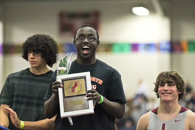 Swardic Mayanja celebrates his New England shot put championship.