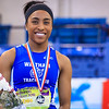 Carla Forbes on award stand for New Balance Indoor Nationals Triple Jump victory.