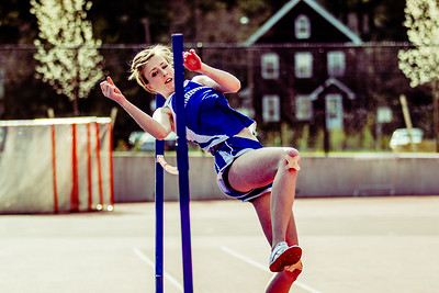 """Mary Donahue recovers after a spill in the hurdles to jump 4'10"""" against Newton North."""