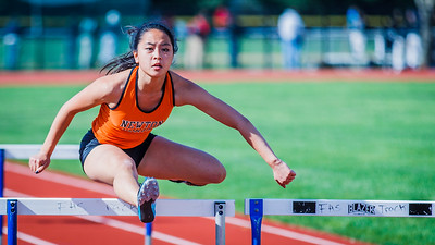 Kayla Wong hurdles against Framingham.